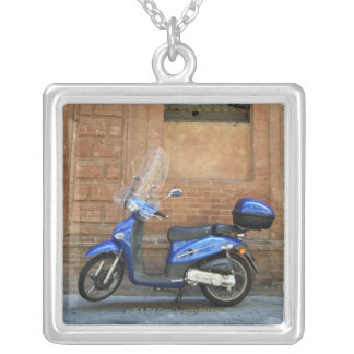 Blue motor scooter by red wall, Siena, Italy Silver Plated Necklace