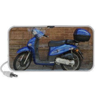 Blue motor scooter by red wall, Siena, Italy Speaker