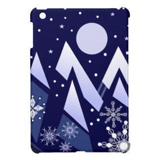 Blue mountains and decorative snowflakes iPad mini case