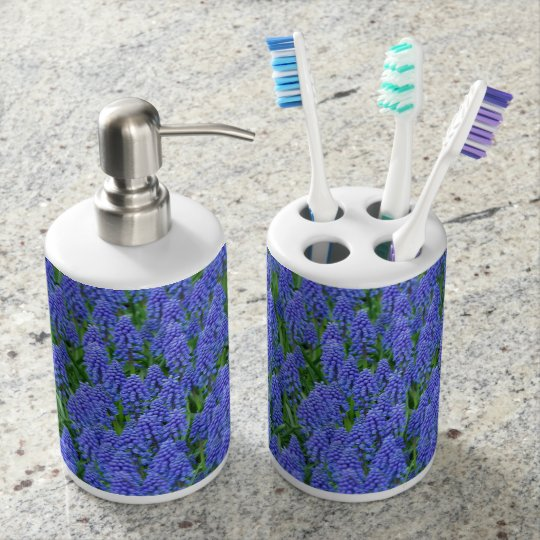 Blue muscari spring flowers soap dispenser and toothbrush