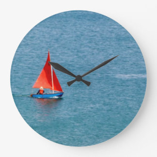 Blue Sailboat with Red Sail at Coverack Cornwall Large Clock
