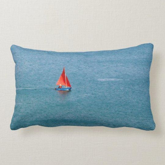 Blue Sailboat with Red Sail at Coverack Cornwall