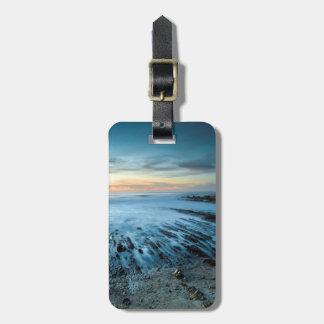 Blue seascape at sunset, California Bag Tag