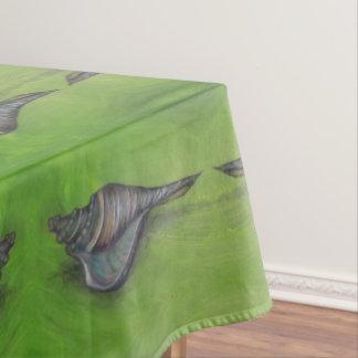 blue seashell on green tablecloth
