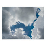 Blue sky and sunlit clouds poster