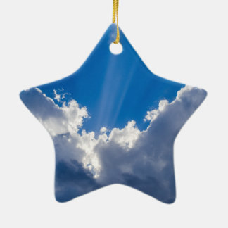 Blue sky with white clouds and ray of sunshine. christmas ornament