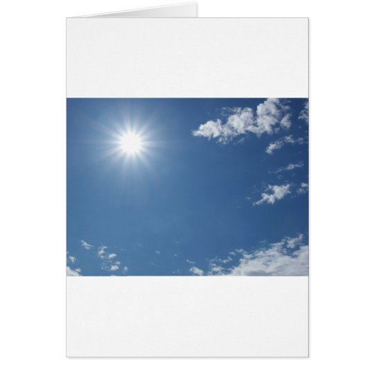 Blue sky with white clouds useful as a background card