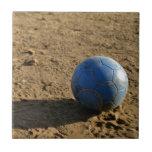 Blue Soccer Ball on Dirt Field Ceramic Tiles