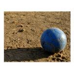 Blue Soccer Ball on Dirt Field Post Card