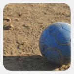 Blue Soccer Ball on Dirt Field Sticker