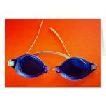 Blue Swimming Goggles on Orange