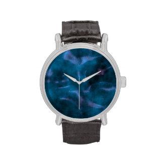 Blue swirls on black watches