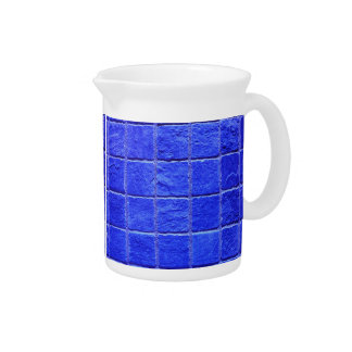 Blue tiles background pitcher