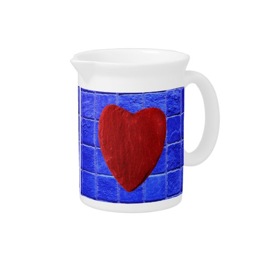 Blue tiles background with heart beverage pitchers