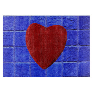 Blue tiles background with heart cutting board
