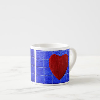 Blue tiles background with heart espresso cup