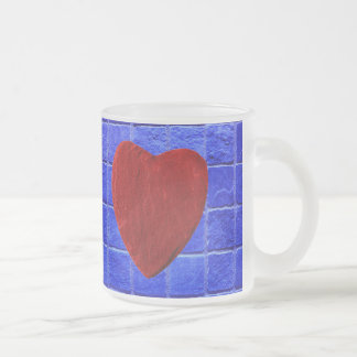 Blue tiles background with heart frosted glass coffee mug