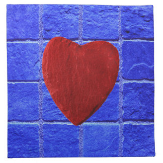 Blue tiles background with heart napkin