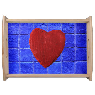 Blue tiles background with heart serving tray