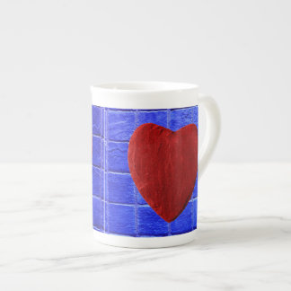Blue tiles background with heart tea cup