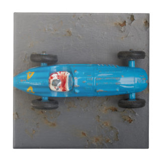Blue toy car small square tile
