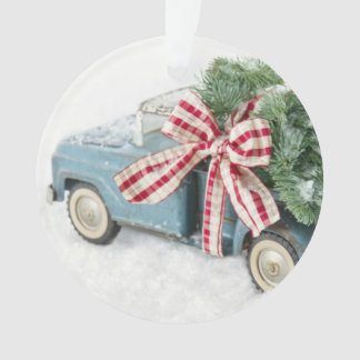 Blue Toy Truck Carrying A Christmas Tree Ornament
