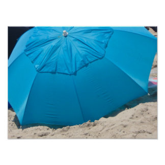 blue umbrella on the beach poster