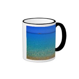 Blue water, Exuma Islands, Bahamas. Mugs