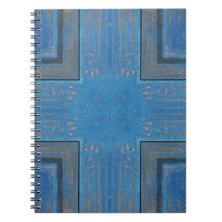 blue wooden background notebooks