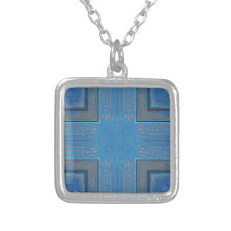 blue wooden background silver plated necklace