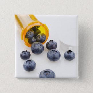 Blueberries spilling from prescription bottle 15 cm square badge
