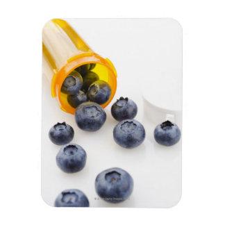 Blueberries spilling from prescription bottle rectangular photo magnet