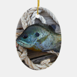 Bluegill fish on dock and rope ceramic oval decoration