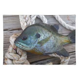 Bluegill fish on dock and rope placemat
