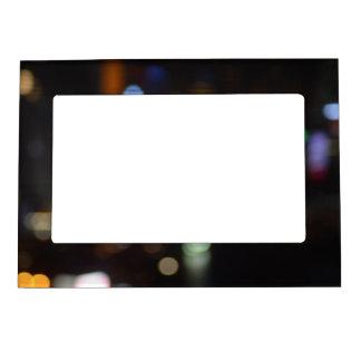 Blurred coloured lights on a black background. magnetic picture frame
