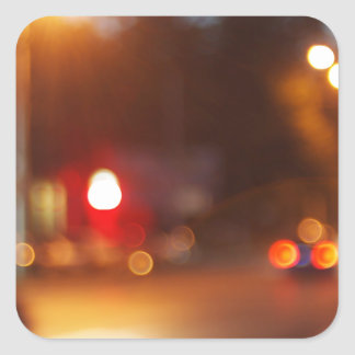 Blurred out of focus lights from cars in a night s square sticker