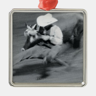 Blurred shot of cowboy wrestling steer christmas ornament