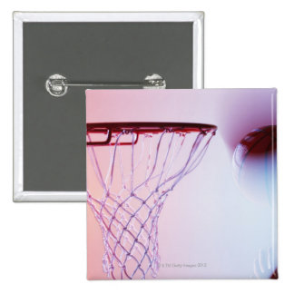 Blurred view of basketball going into hoop 15 cm square badge