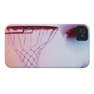 Blurred view of basketball going into hoop iPhone 4 cover