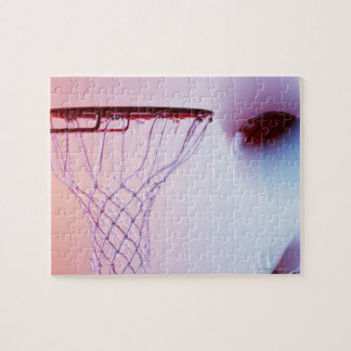 Blurred view of basketball going into hoop jigsaw puzzle