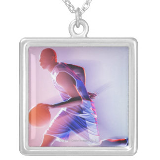 Blurred view of basketball player dribbling silver plated necklace