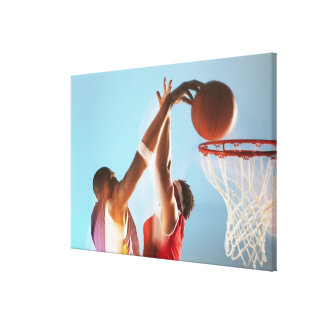 Blurred view of basketball player dunking canvas print