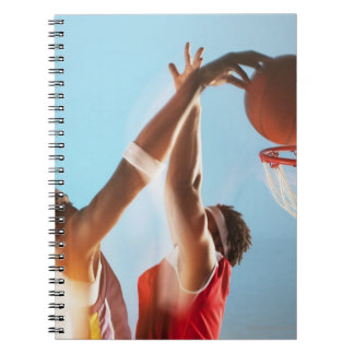 Blurred view of basketball player dunking notebook