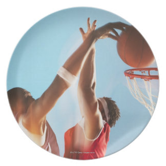 Blurred view of basketball player dunking plate