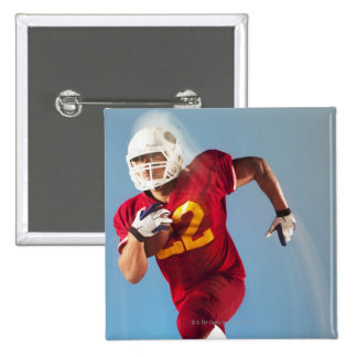 Blurred view of football player running with 15 cm square badge