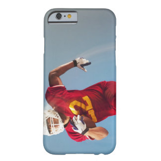 Blurred view of football player running with barely there iPhone 6 case