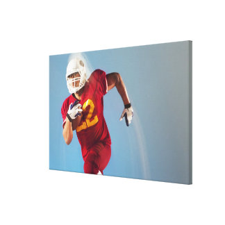 Blurred view of football player running with canvas print