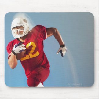 Blurred view of football player running with mouse pad