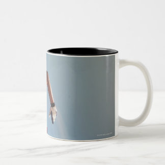 Blurred view of football player running with Two-Tone coffee mug
