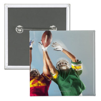 Blurred view of football players reaching for 15 cm square badge